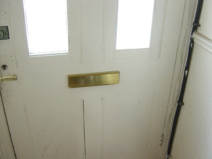 Front door with new internal letterbox