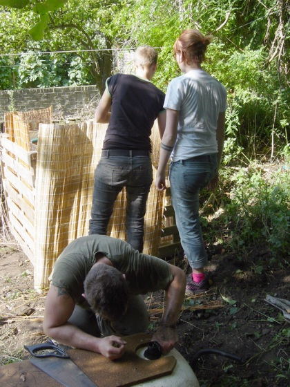 Dean preparing the bath tub and the girls fixing the compost