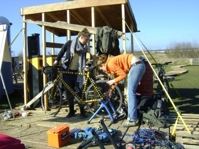 Lucy fixing a bike into the 'trainer'