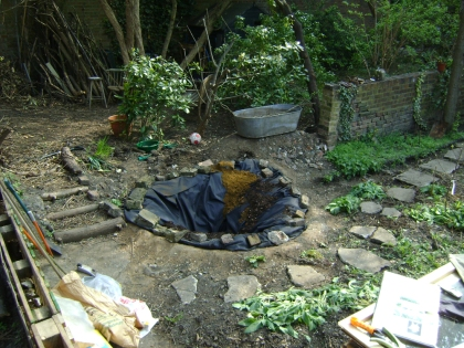 Pond lined with butyl and weighed down at the edges by stones