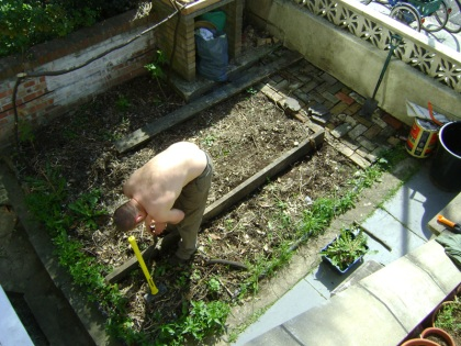Building a raised bed onto the mulched front garden