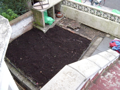 Front garden with path and soil
